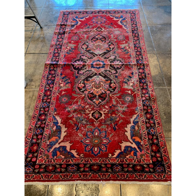 Richly preserved reds and blues and higher pile intricate floral and geometric hand looming work make this an eye catching...