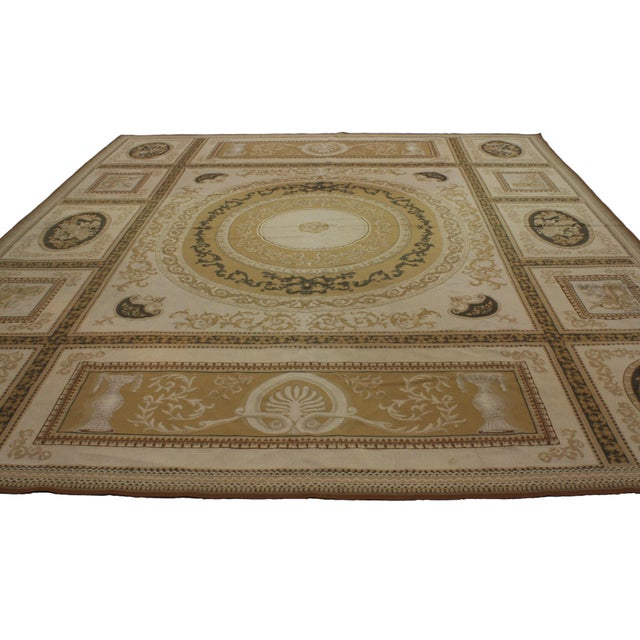 Classic style Aubusson area rug. Soft colors, mix of cool and warm tones.