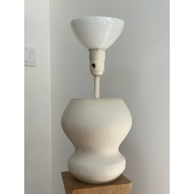 1980's Large scale matte white plaster table lamp designed by Michael Taylor. The lamp measures 28 inches from the bottom...