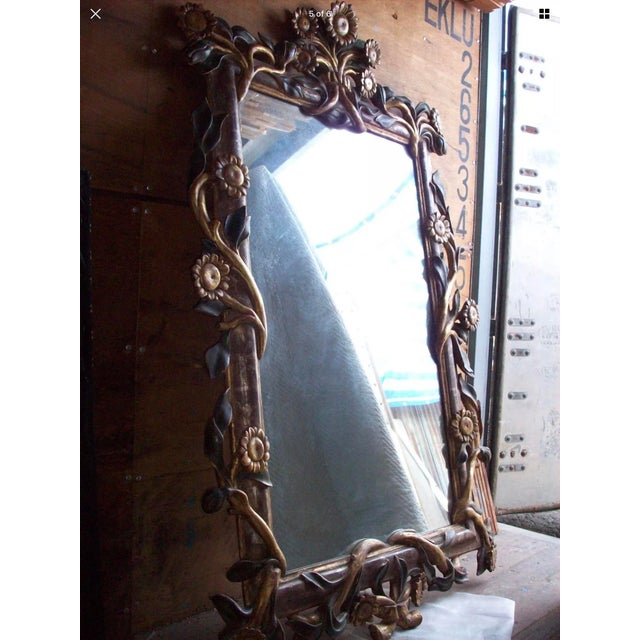 This Sunflower Mirror is a beautiful large centerpiece for any room. It is carved out of solid wood, then genuine 22k gold...