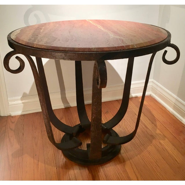 A handsome example after Raymond Subes - variegated and dynamic beveled marble top with well designed wrought iron base -...