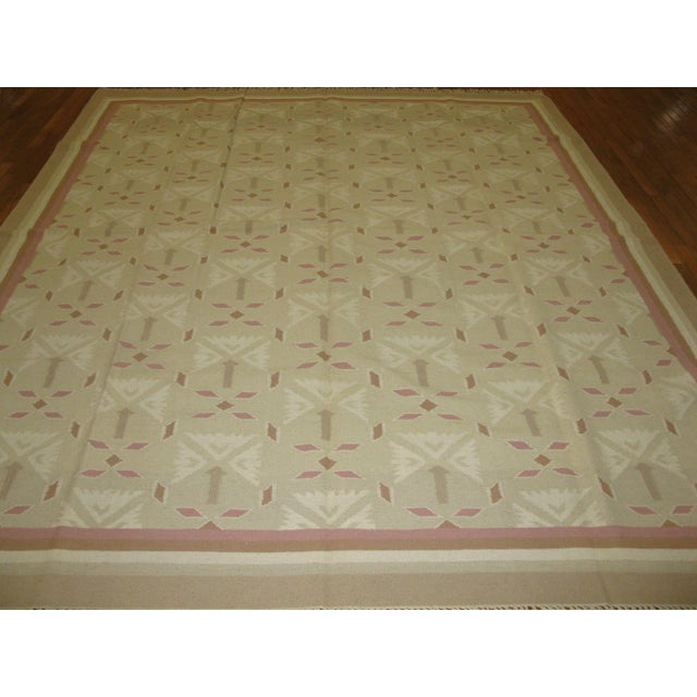 This is a beautiful new hand woven Indian Dhurrie rug with a simple all over pattern in pastel colors. It is made with...