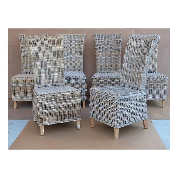 Six high-back wicker rattan dining chairs in the style of Ralph Lauren. Unmarked. Rattan is in great condition with...