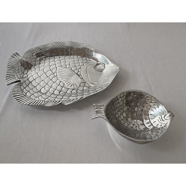 Charming hand-carved aluminum/pewter platter and bowl in playful fish shapes. Handcrafted with a gorgeous shine and...