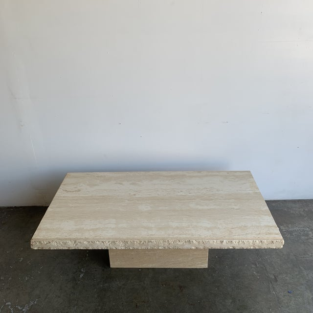 Very well preserved 1970s travertine coffee table. Item offers a clean minimal design, great natural grain, and sits on a...