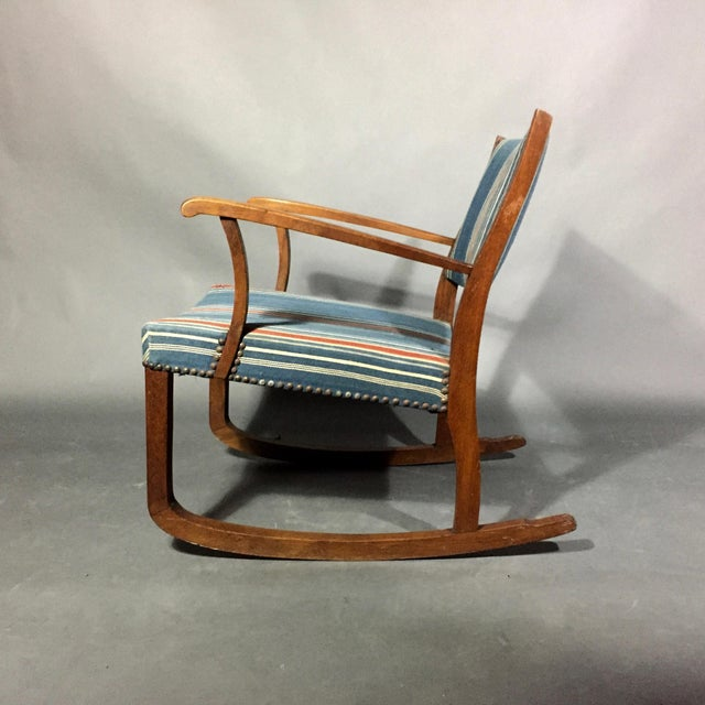 Mid-1940s Scandinavian gently sloped rocking chair with an oak frame and perfectly Danish striped wool fabric in blues and...