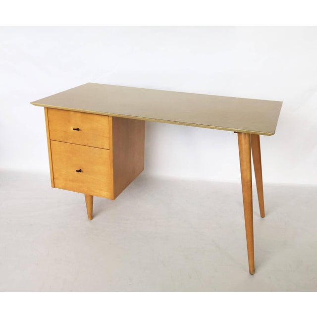 Solid maple medium size desk supported by drawers on one side and the signature angular tapered legs on the other. There...