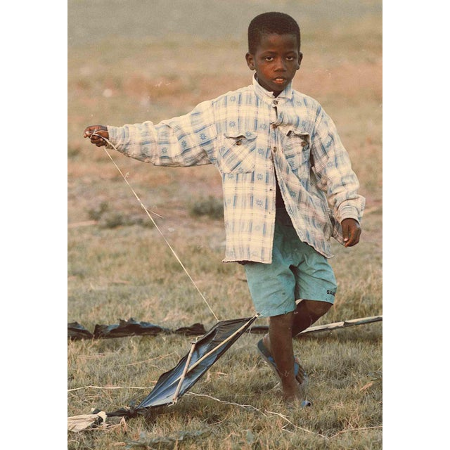 "Contemporary Photography ""Flying Kite"" by Douglas Condzo A boy playing with a flying kite, made in an artisanal way with..."