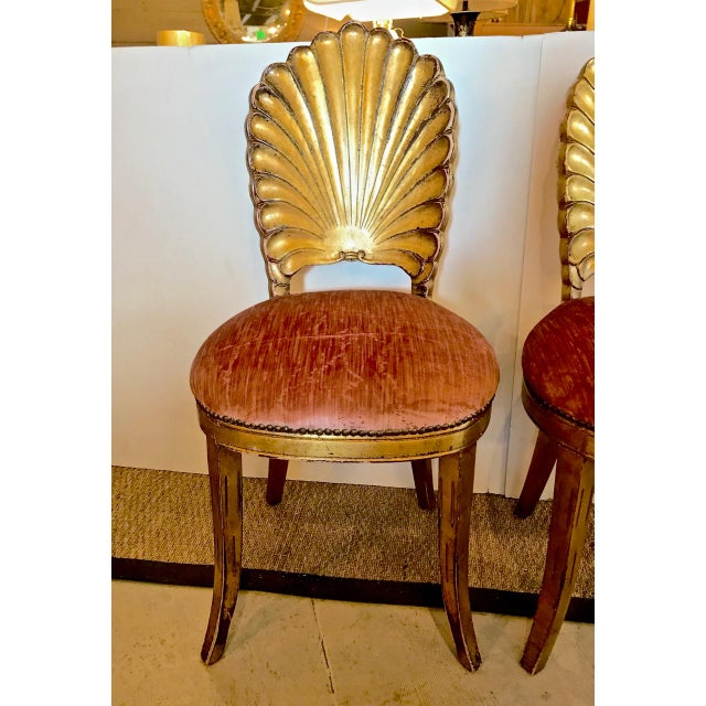 This is an iconic pair of mid-century Venetian Grotto Chairs that have been gold leafed and are newly upholstered in a...