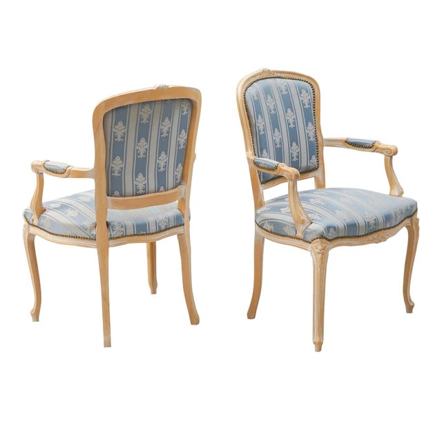 Pair of classic Rococo chairs Classic Rococo chair with hand carved floral details to the frame and padded arm rests.