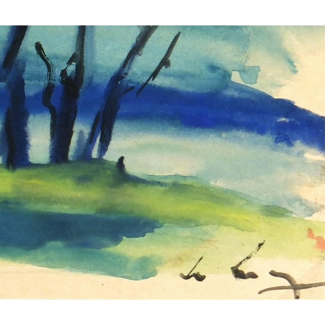 Hues of gold, blue, and green blend together in this arching landscape of trees against a setting sun, circa 1980. Signed...