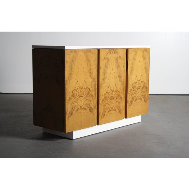 Petite burl wood 2-tone credenza/buffet in the manner of Milo Baughman. The cabinet faces and sides are finished with a...