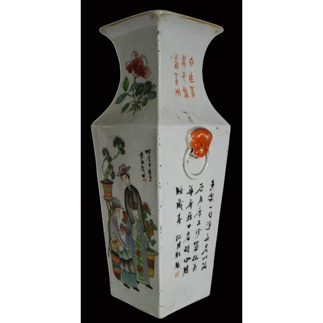 A Chinese, 19th century vase with scenes hand-painted on porcelain. This vase adopts a traditional Chinese square shape...