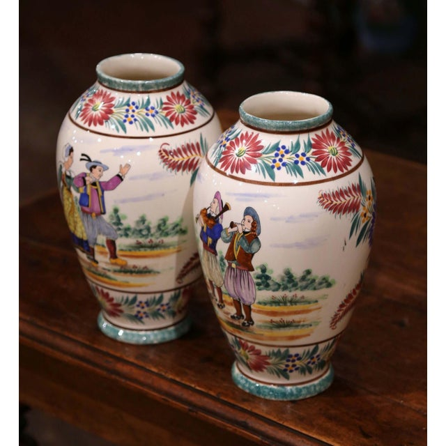 Decorate a mantel or table with this colorful pair of antique faience vases. Crafted in Brittany, France, circa 1930, both...