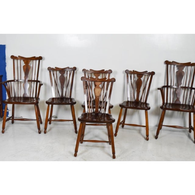 Set of Vintage Stickley dining room chairs. Two captains chairs and four side brace-back chairs. Chairs show signs of wear...