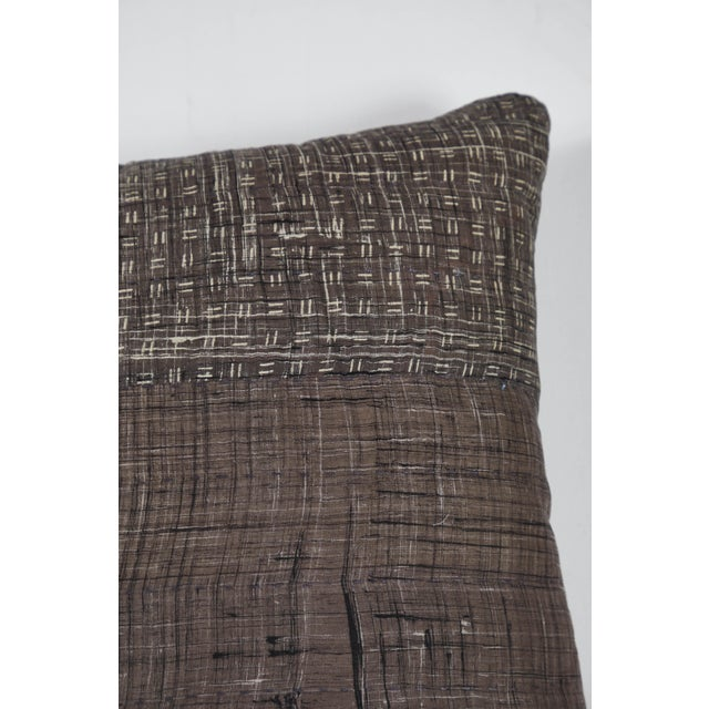 Double sided pillow made from hand painted, block-printed and over dyed Indian cotton. all-over quilting stitches on...