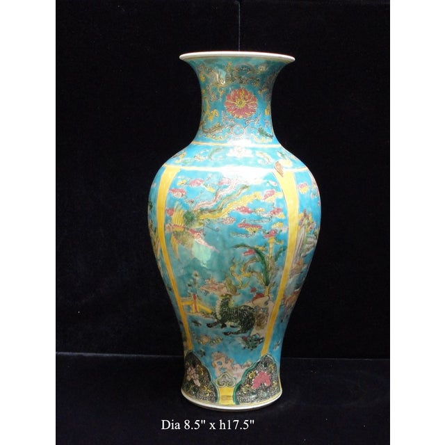 This Chinese decorative blue yellow base porcelain vase has hand painted color graphic of phoenix, Kirin, animals scenery...