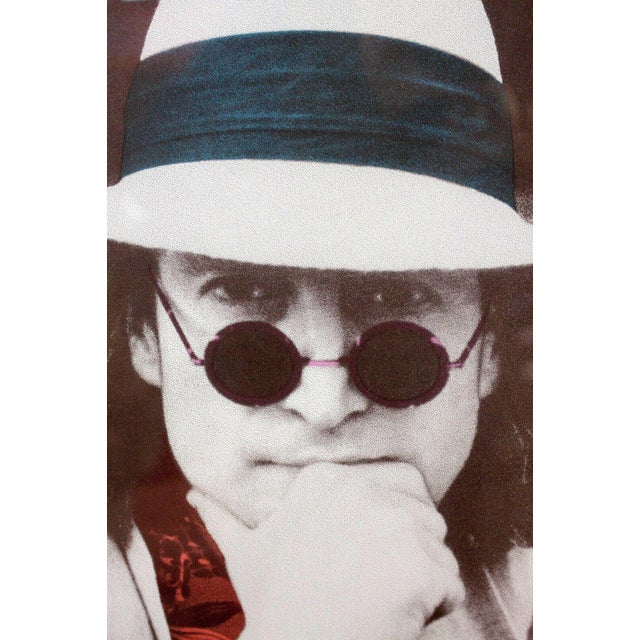 This is a rich and emotive vintage limited edition hand-pulled silk screen serigraph print of a portrait of John Lennon,...