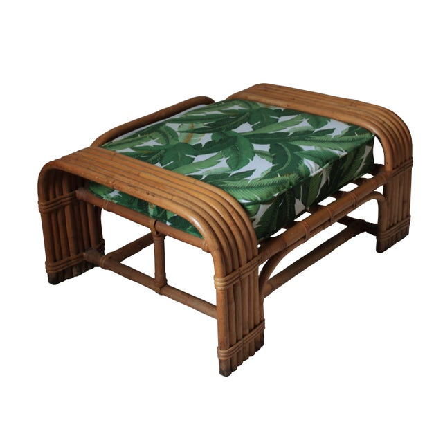 This gorgeous 1930s-40s rattan ottoman is a special find for your living room or patio. The original spring cushion was...