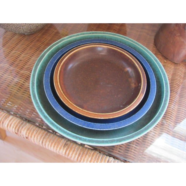 We are selling a set of three low ceramic nesting bowls from SAXBO Kilns of Denmark. The bowls were designed by noted...