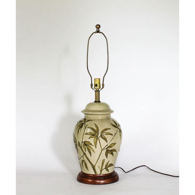Celadon green lamp by Frederick Cooper with bamboo tree motif. Wired and in working condition. Uses standard 60 watt bulb....