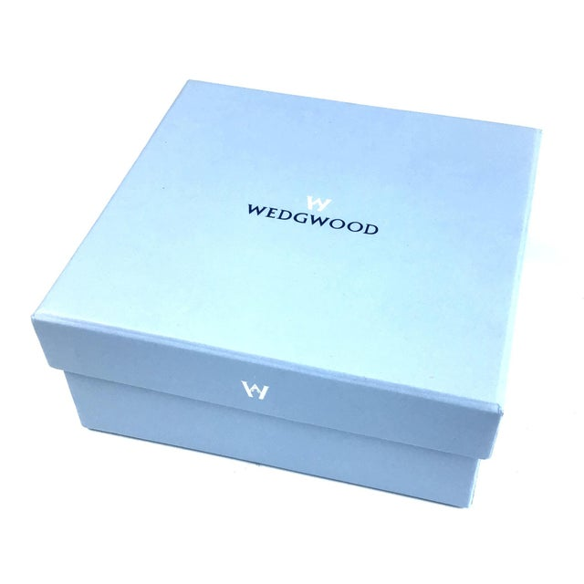 New and gift boxed set of Salt & Pepper shakers by Wedgwood. The top of each shaker is adorned with the trademark Black...