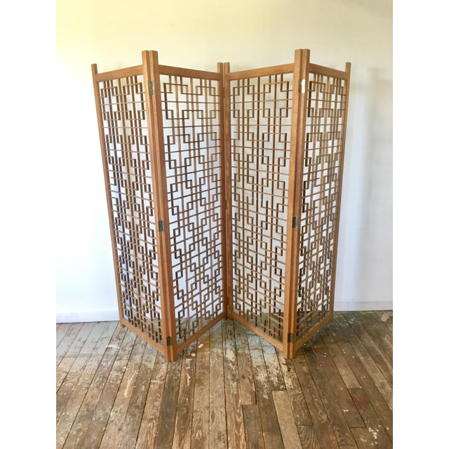 An awesome Mid-Century Modern screen / room divider made from Teak. This piece is so great and the geometric pattern...