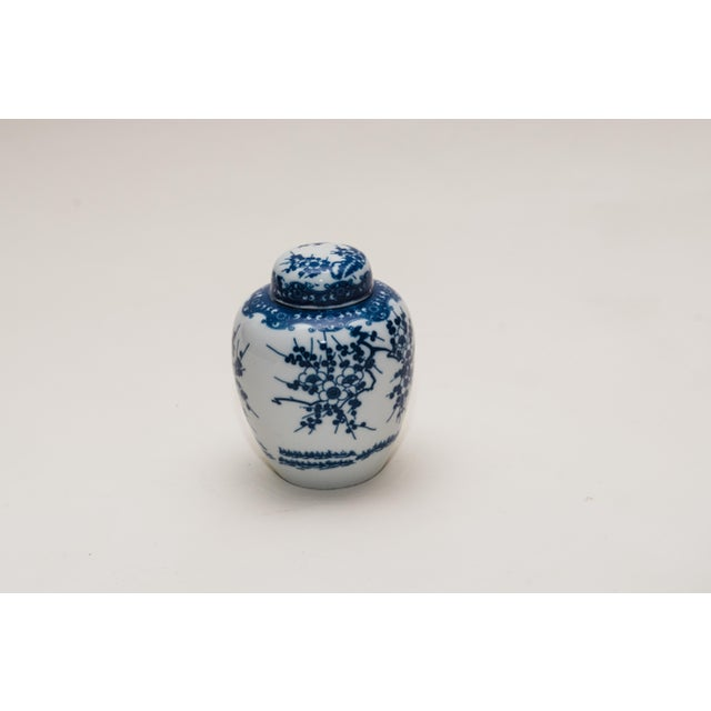 A vintage Chinese porcelain blue & white ginger jar featuring cherry blossoms.