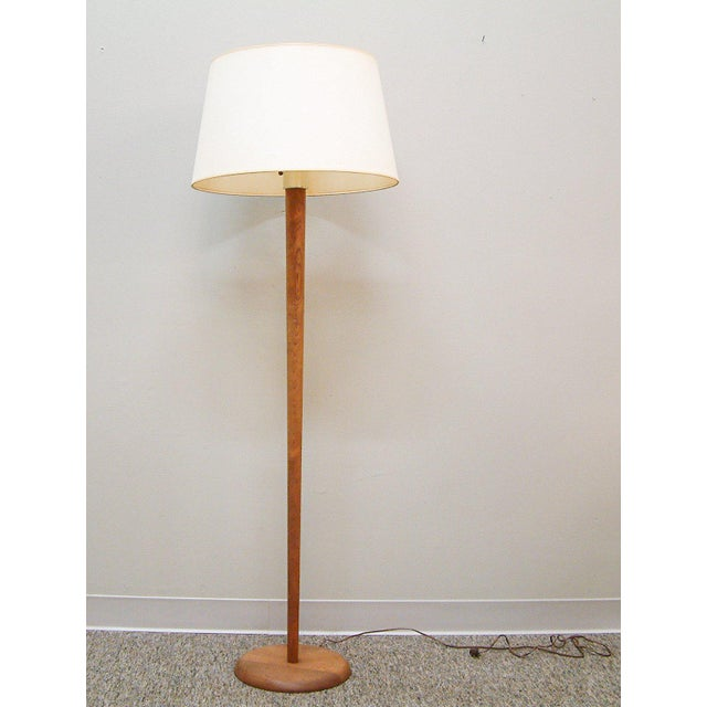 United States Circa 1950 A finely executed floor lamp attributed to Vladimir Kagan with a single socket, glass diffuser...