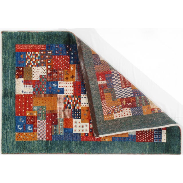 GorgeousPersian Gabbeh rug. Hand-knotted. Hand-Spun Wool Fine lamb's wool. The lovely piece of your home. This rug has a...