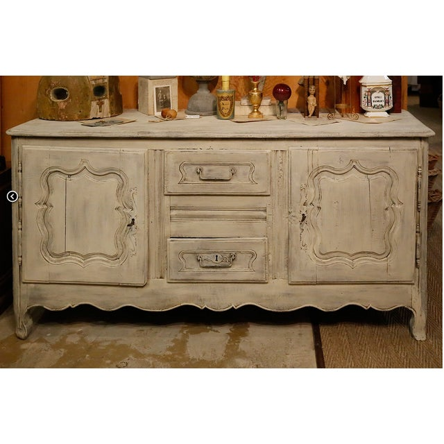 Beautiful 18th C buffet from Alsace with original painted finish. Features two drawers and two cabinet spaces with...