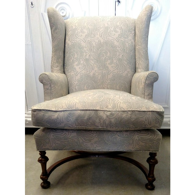 This is a beautiful, vintage, newly re-upholstered wingback chair. The wood legs are supported by semi-circular wooden...