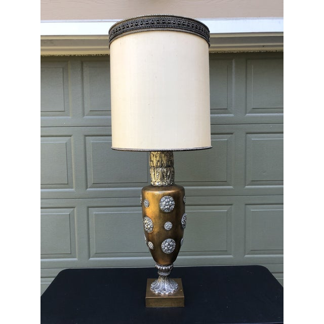 Spectacular statement lamp! Heavy plaster gilt base adorned with silver plaster overlay medallions for a renaissance vibe....