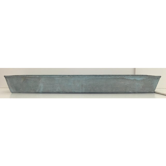 Steel rectangular trough style planter with angled side. Rustic weathered painted patina finish. Used outdoors. Smaller...
