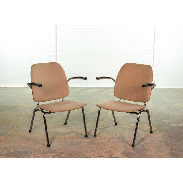 This set of two comfortable vintage armchairs was designed in the 1960s by Martin de Wit for Gispen. They feature chromed...