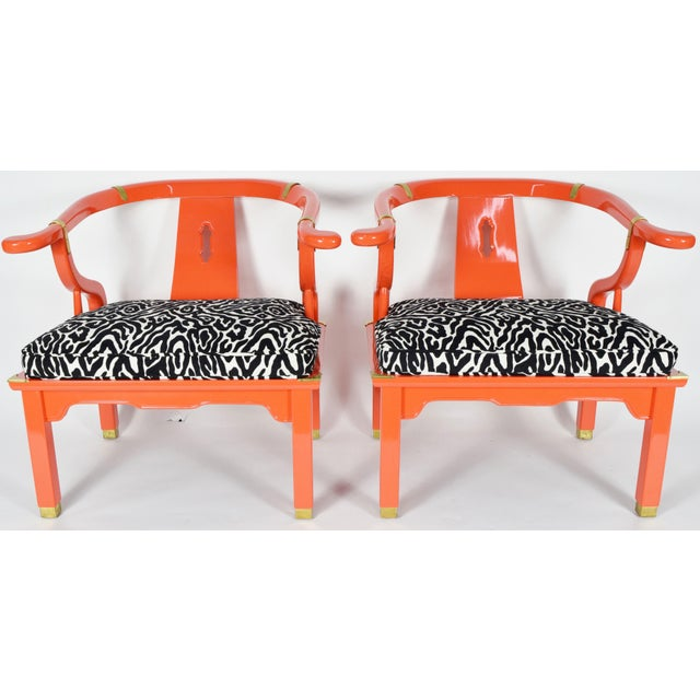 Pair of Asian-style Ming chairs in the style of James Mont. Chairs are by Century Furniture Company. They have been newly...