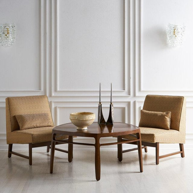 A pair of 1950's Edward Wormley for Dunbar Slipper Chairs. Featuring a sculptural mahogany wood frame and original...