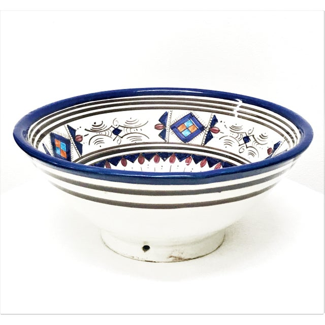 This intricately patterned handcrafted blue Berber square ceramic bowl will add an exotic touch of color and...