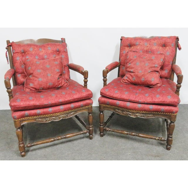 Country French style chairs, Oak frames with floral carved accents, slat backs, turned stretchers and legs.