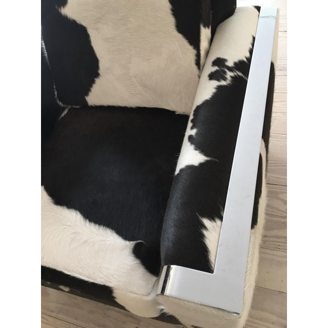 """Vintage armchair, """"re-visioned"""" by FRG. Black & white Brazilian cowhide & polished chrome. This vintage black & white..."""