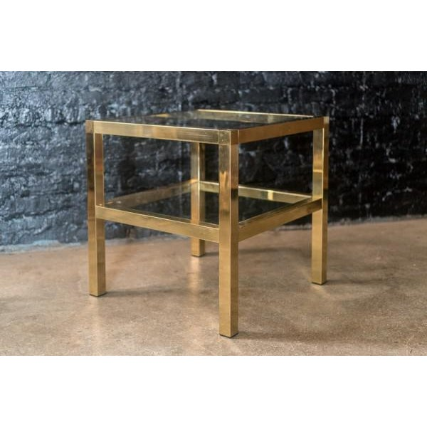 Timeless modern streamline design. elegant solid brass & glass two tiered side table makes for the perfect transitional...