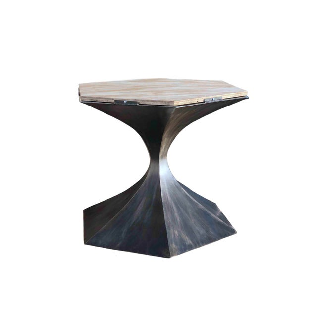 Made in the USA, this unique handmade six sided metal table base is a show stopper. Inspired by the Saarinen Tulip table,...