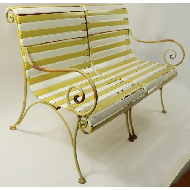 Cool Woodard settee sofa loveseat, in original condition. This example has a wrought iron scroll arm with alternating...