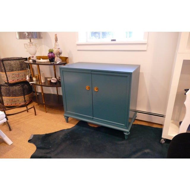 Teal two-door chest from Century Furniture with interior shelves and gold hardware on doors. Beautiful, well-built piece...