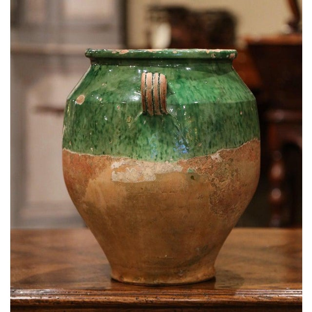 Very difficult to find with green glazing, this large colorful French confit pot with a glaze upper portion was created in...