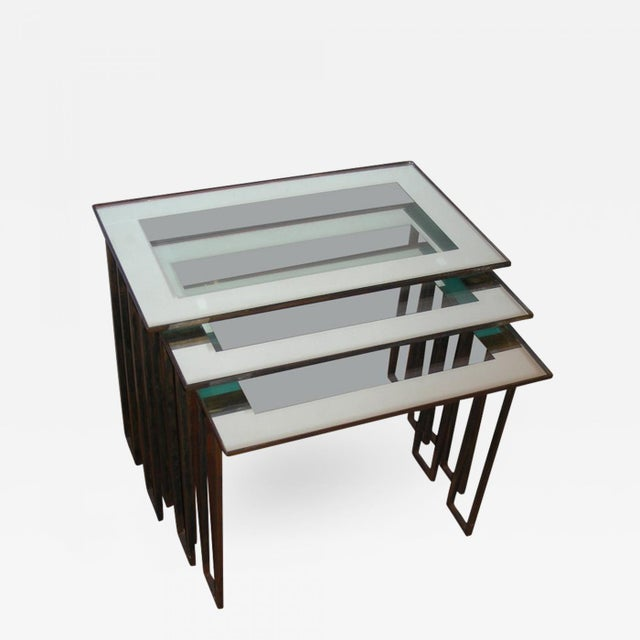 """Jean Royère Three 1950s nesting tables with base in gilt wrought iron. Middle table : H15,5""""/D11,8""""/W18,11"""". Smallest..."""