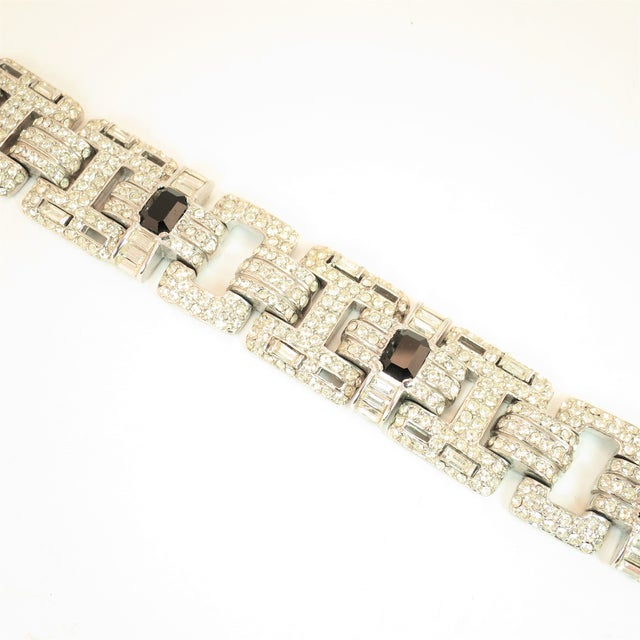 Offered here is a massive Ciner Art Deco-style heavy link bracelet in an open-work geometric design from the 1950s. The...