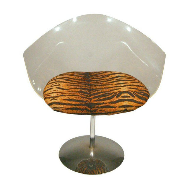 """Recovering Included."""" These """"Jet Age"""" Lucite and chrome swivel chairs by Charles Hollis Jones feature elegant fan backs...."""