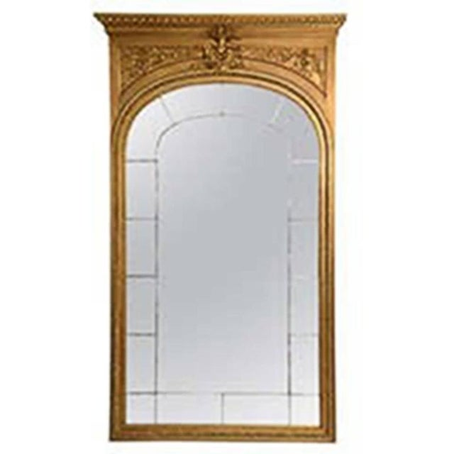 This is an unusually large French giltwood mirror with a straight egg and dart cornice over a deep frieze with a central...