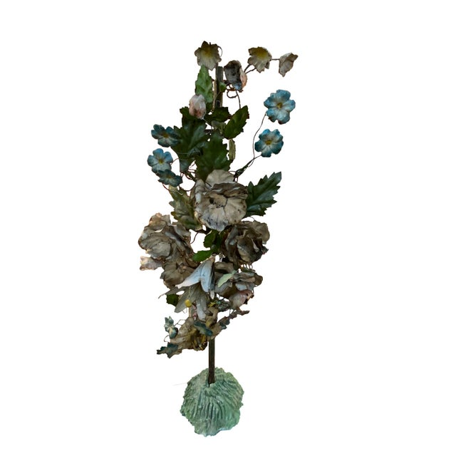 Highly decorative pair of French tole topiaries of painted flowers and leaves in varying colors.